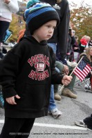 A young man watches the 2014 Veterans Day Parade