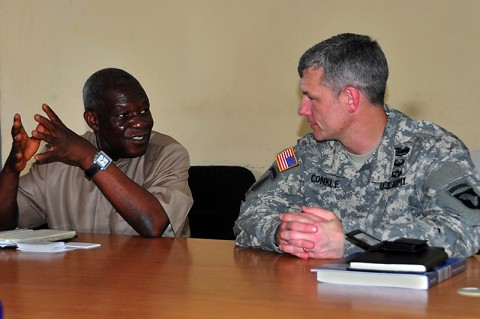 T. Edward Liberty, left, Ph.D., the director general of the Liberian Institute of Statistics – Geo-Information Services, discusses his vision of his newfound partnership with the Joint Forces Command – United Assistance geospatial team with Lt. Col. David Conkle, the assistant chief of staff of intelligence for JFC-UA, during a meeting Oct. 29, 2014, at the LISGIS headquarters in Monrovia. (Sgt. 1st Class Nathan Hoskins)