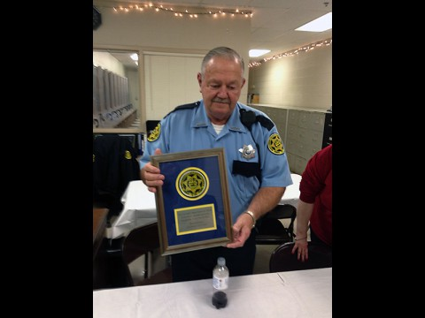 Montgomery County Sheriff's deputy Eugene Hinkle displays his plaque.