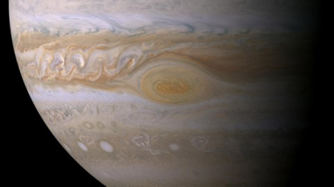 Research suggests effects of sunlight produce the color of Jupiter's Great Red Spot. The feature's clouds are much higher than those elsewhere on the planet, and its vortex nature confines the reddish particles once they form. (NASA/JPL-Caltech/ Space Science Institute)
