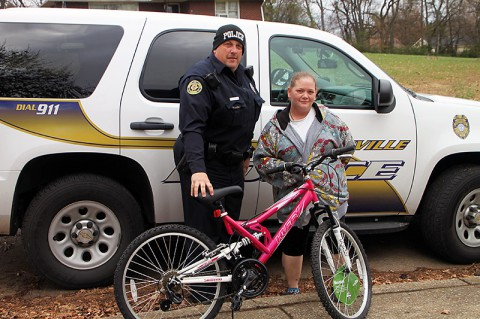 Clarksville Police Officer Jeff Derico and Ms. Larissa Taylor.