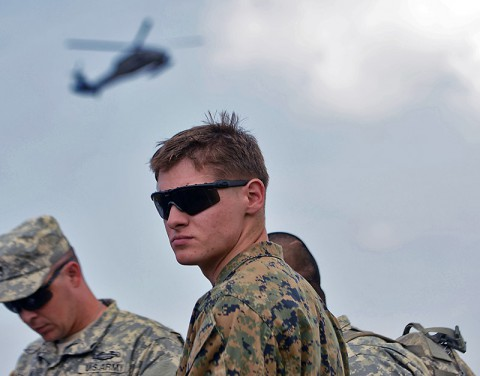 Marine Cpl. Brandon Gohn, team leader, Company F, 2nd Battalion, 2nd Marine Regiment, Camp LeJeune, N.C., waits for the helicopter that will take him and Maj. Gen. Gary Volesky, the Joint Forces Command – United Assistance commander, around to see the positive effects of Operation United Assistance in Monrovia, Liberia, and surrounding areas, Nov. 28, 2014. Gohn was recognized as the first Service Member of the Week; a weekly recognition program that will highlight outstanding service members who are deployed in support of OUA. (Sgt. Matt Britton 27th Public Affairs Detachment)