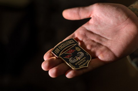 The coin Maj. Gen. Gary Volesky, the Joint Forces Command – United Assistance commander, awards to soldiers for going above and beyond their jobs. (Spc. Rashene Mincy, 55th Signal Company)
