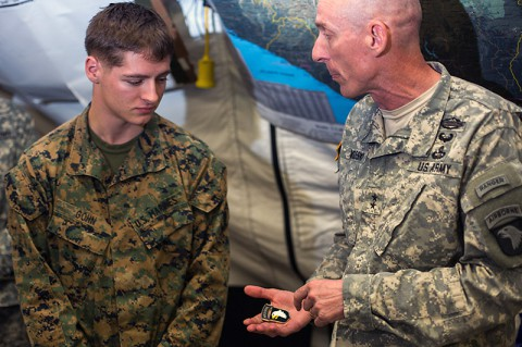 Marine Cpl. Brandon Gohn, left, team leader, Company F, 2nd Battalion, 2nd Marine Regiment, Camp LeJeune, N.C., receives a coin and is recognized by Maj. Gen. Gary Volesky, the Joint Forces Command – United Assistance commander, at the Barclay Training Center in Monrovia, Liberia, Nov. 28, 2014. This Friday marked the beginning of a weekly recognition program for the troops who are deployed to Liberia in support of Operation United Assistance. Gohn is the first to be recognized as Service Member of the Week. (Spc. Rashene Mincy, 55th Signal Company)