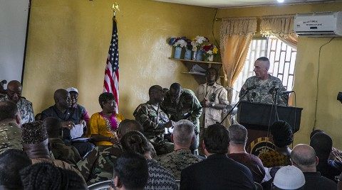 Maj. Gen. Gary Volesky, right, the Joint Forces Command – United Assistance commander addresses Ambassador Joseph N. Boakai, far left, vice president of the Republic of Liberia, and his staff at the dedication of Ebola treatment unit ceremony in Tubmanburg, Liberia, Nov. 10, 2014. (U.S. Army photo by Staff Sgt. Terrance D. Rhodes)