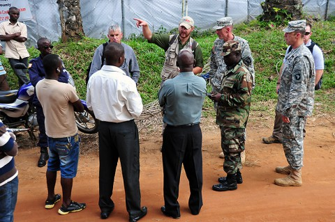 From right, Sam Sells, military liaison officer, U.S. Agency for International Development, Lt. Col. Lee Hicks, JFC-UA command engineer, Armed Forces of Liberia Capt. A. J. Halley Moore, 1st Battalion commander, Maj. Gen. Gary Volesky, commander of the Joint Forces Command – United Assistance, Scott Dehnisch, military liaison officer, USAID, and Gregg Gross, engineering contractor, talk to local medical officials Nov. 3, 2014, about the placement of a planned Ebola treatment unit in Ganta, Liberia. (U.S. Army photo by Sgt. 1st Class Nathan Hoskins)