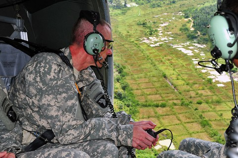 Maj. Gen. Gary Volesky, commander of the Joint Forces Command – United Assistance, surveys the sprawling vegetation of Liberia Nov. 3, 2014, while on his way to Ganta, Liberia, to discuss the site of a future Ebola treatment unit. Volesky traveled with representatives from the Armed Forces of Liberia and the U.S. Agency for International Development, which is the lead agency in the U.S. government and international effort to contain Ebola in West Africa. (U.S. Army photo by Sgt. 1st Class Nathan Hoskins)