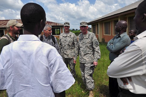 A team comprised of representatives from Joint Forces Command – United Assistance, the Armed Forces of Liberia, and the U.S. Agency for International Development – the lead U.S. agency charged with containing the spread of Ebola in West Africa – along with city officials in Ganta, Liberia, survey an area for construction of an Ebola treatment unit Nov. 3, 2014. (U.S. Army photo by Sgt. 1st Class Nathan Hoskins)