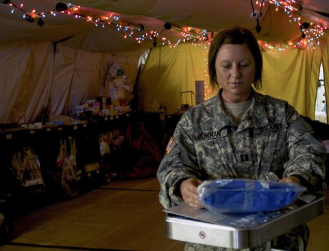 Capt. Melanie Bowman, a Camden, Tenn., native and officer in charge for the 86th Damage Control Resuscitation Team, 86th Combat Support Hospital, Fort Campbell, Ky., prepares medical supplies at the Joint Forces Command – United Assistance Field Hospital, Dec. 16, 2014. The field hospital has the equipment and personnel to address any immediate medical emergency in theater. (Sgt. Dani Salvatore, 27th Public Affairs Detachment)