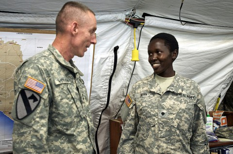 Specialist Rysper Sirma, food inspection specialist, 463rd Medical Detachment (Veterinary Services), Joint Forces Command – United Assistance, is recognized for her exemplary performance while supporting Operation United Assistance by Maj. Gen. Gary Volesky, commander of JFC-UA, Dec. 26, 2014, at the Barclay Training Center, Monrovia, Liberia. Each week a service member supporting OUA is formally recognized by Volesky, who awards him or her with a division coin, followed by a helicopter ride with the commander around the joint operations area. Operation United Assistance is a Department of Defense operation in Liberia to provide logistics, training and engineering support to U.S. Agency for International Development-led efforts to contain the Ebola virus outbreak in western Africa. (Staff Sgt. V. Michelle Woods/U.S. Army)
