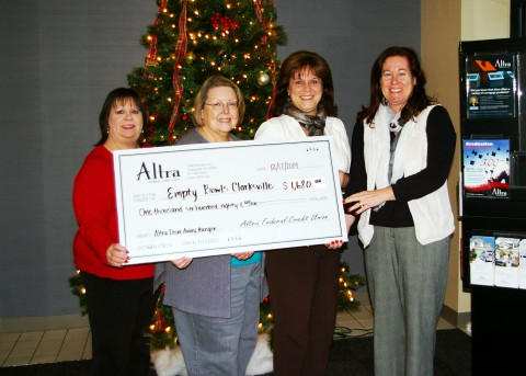 Altra Federal Credit Union presents the donation check to Empty Bowls Clarksville