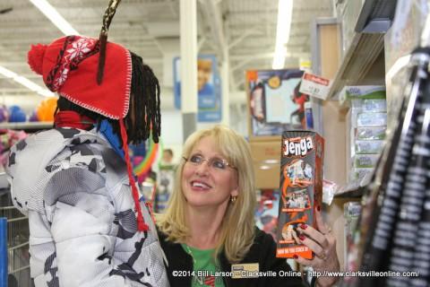 Realtor Sherry Davis shows her shopper a Jenga game