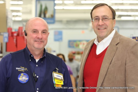 Store manager Lanny Barker with Mark Holleman
