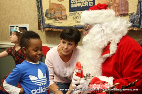 Santa visits with one of the shoppers