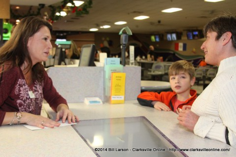 Amy Carroll, the executive director of Big Brothers, Big Sisters manning the counter at the Pinnacle Bowling Alley