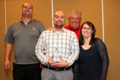 "James Jenkins receives the ""Rising Star"" award from Convenient Car Care Inc. during the annual Christmas and Employee Recognition dinner.  Pictured are Brian Banning, Jenkins, Doug Wall, and Candace Ursery (Bill Larson/Clarksville Online)"