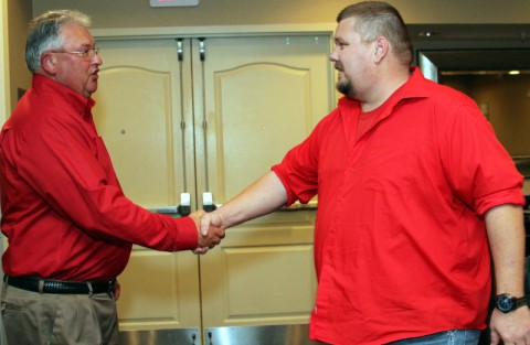 """Convenient Car Care Inc. owner Doug Wall, congratulates David Thompson for being awarded """"Store of the Year."""" (Bill Larson/Clarksville Online)"""