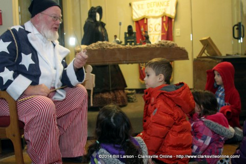 Santa Claus tell stories to children at Christmas in Occupied Clarksville at the Fort Defiance Interpretive Center