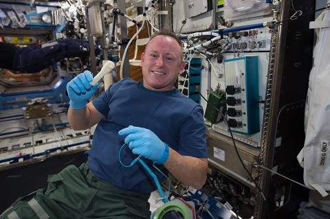 "International Space Station Expedition 42 Commander Barry ""Butch"" Wilmore shows off a ratchet wrench made with a 3-D printer on the station. The wrench and other parts will return to Earth for testing at NASA's Marshall Space Flight Center in Huntsville, Alabama. (NASA)"