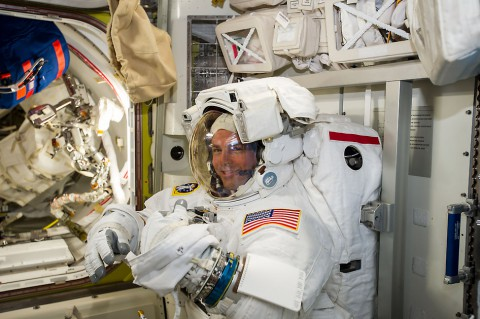 NASA astronaut Reid Wiseman checks his spacesuit in preparation for the first Expedition 41 spacewalk. (NASA/ESA/Alexander Gerst)