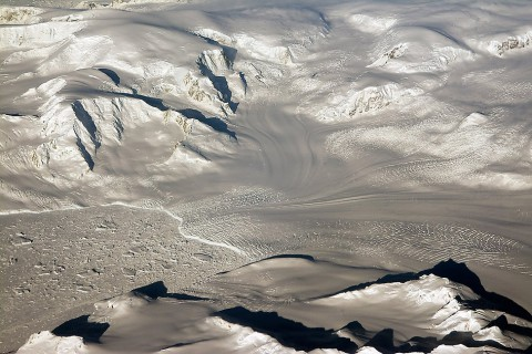 Glaciers and mountains in the evening sun are seen on an Operation IceBridge research flight, returning from West Antarctica. (NASA/Michael Studinger)