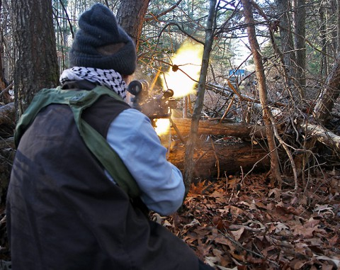 A soldier from Charlie Company, 1-327 Infantry Regiment, 101st Airborne Division fires a M249 Squad Automatic Weapon (SAW) on A.P. Hill, Va., Jan. 16, 2015. The soldier is acting as the opposing forces (OPFOR) facilitating the 78th Training Division's Warrior Exercise (WAREX) 78-15-01. (Spc. Matthew Elmore, 78th Training Division)