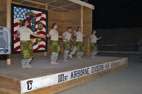 From left, Sgt. 1st Class Christabel Jennings, Warrant Officer Abigail Baker, Pfc. Timothy Cruz, Spc. Sally Rodriguez and Maj. Jessica Higa, all with the 101st Sustainment Brigade, Task Force Lifeliner, Joint Forces Command – United Assistance, dance the Pate Pate dance for the Buchanan talent show to celebrate the New Year at Camp Buchanan, Buchanan, Liberia, Dec. 31, 2014. (Sgt. 1st Class Mary Rose Mittlesteadt, 101st Sustainment Brigade Public Affairs)