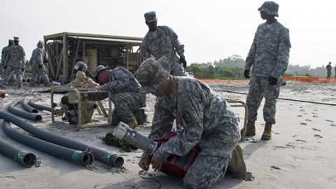 Pvt. 1st Class Tieyu Zhang with the 227th Quartermaster Company, 129th Combat Sustainment Support Battalion, 101st Sustainment Brigade, Task Force Lifeliners, Joint Task Force - United Assistance, prepares a pump to be put into the seawater as part of the employment of a tactical water purification system (TWPS) at a waterfront in Buchanan, Liberia, on Jan. 8, 2015. The TWPS is a logistical capability that is used to provide clean water for forces supporting Operation United Assistance. (Sgt. 1st Class Mary Rose Mittlesteadt, 101st Sustainment Brigade)