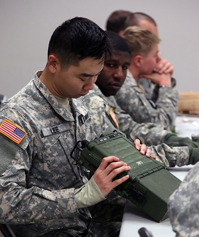 A Soldier from 1st Brigade Combat Team, 101st Airborne Division receives hands-on radio training from 5th Special Forces Group Jan. 12 on Fort Campbell. The training concluded a five-part combined training exercise between the two units. (Spc. Robert Venegas, 5th SFG(A) Combat Camera)