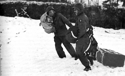 101st Airborne Division personnel retrieve an A-4 Aerial Delivery Container containing medical supplies. Photo taken in the Bastogne area. Resupply missions took place between 23-27 December 1944.