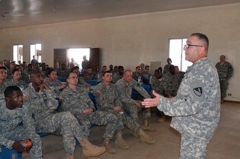 Chaplain Maj. Alfred Grondski, right, a Trenton, N.J., native, of Headquarters and Headquarters Brigade, 36th Engineer Brigade, briefs Soldiers about redeployment stresses they might endure when they get home, during the Operation United Assistance mission, at the National Police Training Academy, Payenesville, Liberia. Dec. 31, 2014. (Sgt. Ange Desinor 13th Public Affairs Detachment)
