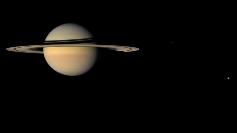 Researchers have determined the location of the Saturn system's center of mass to within just a couple of miles (or kilometers), a factor of 50 improvement over previous knowledge. (NASA/JPL/Space Science Institute)
