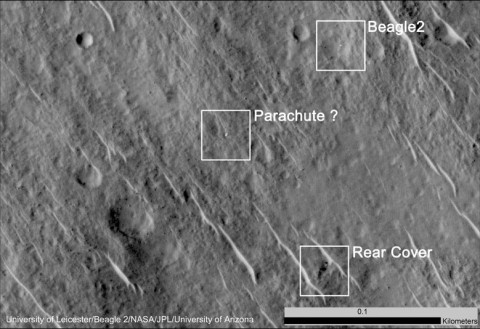 This annotated image shows where features seen in an observation by NASA's Mars Reconnaissance Orbiter have been interpreted as hardware from the Dec. 25, 2003, arrival at Mars of the United Kingdom's Beagle 2 Lander. The image was taken in 2014 by the orbiter's HiRISE camera.