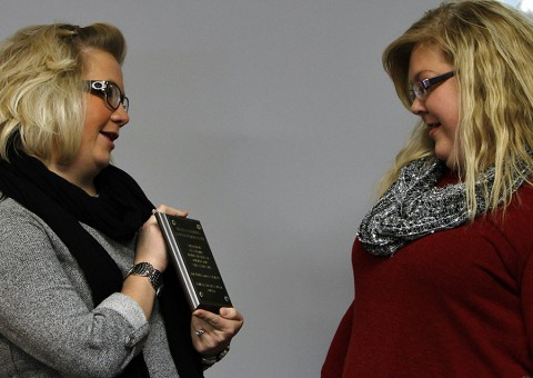 "Campus Director, Kala Fielder, presents Gina Castleberry with personal plaque at the ceremony naming the campus learning resource Center, the ""Gina Castleberry Learning Resource Center."" (Lois Jones)"