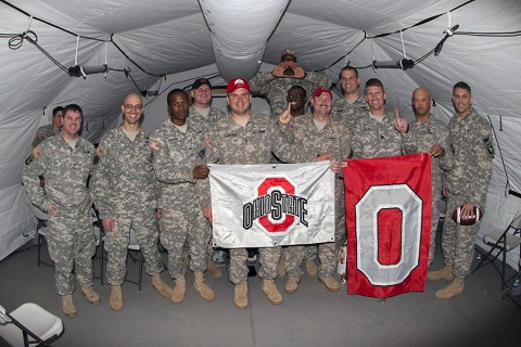 Soldiers deployed in support of Operation United Assistance in Monrovia, Liberia, gather together for a group photo after watching their Ohio State University Buckeyes win the College Football Playoff Championship game, Jan. 13, 2015. The dedicated fans stayed up until 5 a.m. when the game ended. (U.S. Army photo by Sgt. 1st Class Nathan Hoskins, 101st Airborne Division Public Affairs)