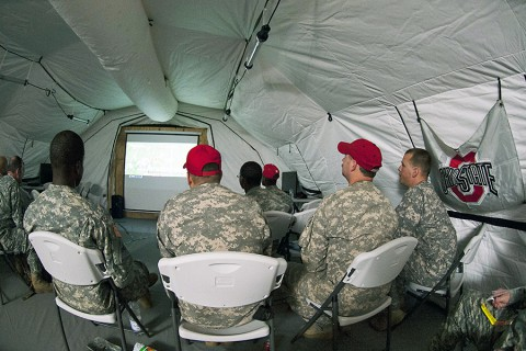 Soldiers deployed in support of Operation United Assistance in Monrovia, Liberia, watch their Ohio State University Buckeyes during the College Football Playoff Championship game, Jan. 13, 2015. The dedicated fans stayed up until 5 a.m. when the game ended. (U.S. Army photo by Sgt. 1st Class Nathan Hoskins, 101st Airborne Division Public Affairs)