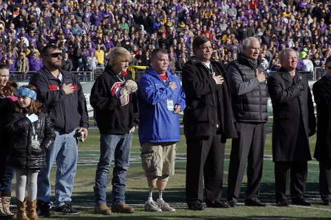 Eight wounded warriors, their families, and two Gold Star families were invited to the Franklin American Mortgage Music City bowl to be honored during each event leading up to the game on Dec. 30, 2014. Before the game, the group stood on the field during the singing of the national anthem.