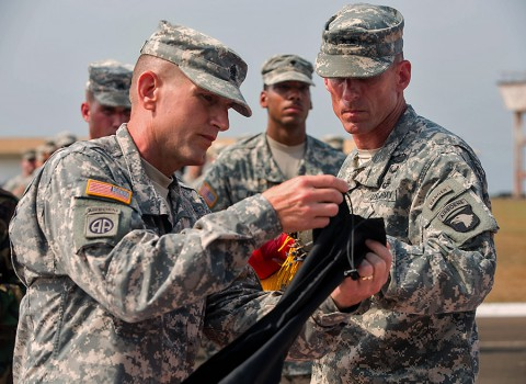 Command Sgt. Maj. Gregory Nowak, left, Joint Forces Command – United Assistance and 101st Airborne Division (Air Assault) senior enlisted adviser, and Maj. Gen. Gary Volesky, commander of JFC-UA and 101st, case their unit colors during a ceremony held at the Barclay Training Center, Monrovia, Liberia, Feb. 26, 2015. (Spc. Rashene Mincy, 55th Signal Company (Combat Camera))