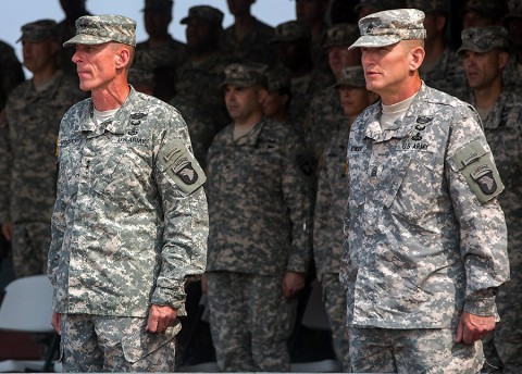 Maj. Gen. Gary Volesky, left, commander of Joint Forces Command – United Assistance and the 101st Airborne Division (Air Assault), and Command Sgt. Maj. Gregory Nowak, right, JFC-UA and 101st senior enlisted adviser, sing the Screaming Eagle Song, a tradition held during all 101st Airborne Division ceremonies, Feb. 26, 2015, Barclay Training Center, Monrovia, Liberia. (Spc. Rashene Mincy, 55th Signal Company (Combat Camera))