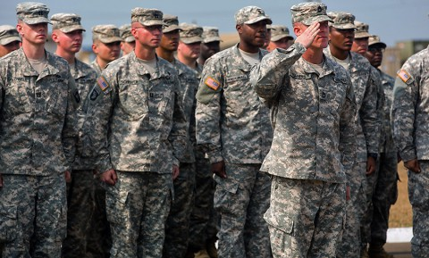 Sgt. 1st Class Anthony Harris, platoon sergeant, 2nd Platoon, Division Signal Company, takes charge of the formation from Maj. Gen. Gary Volesky, the commanding general of the Joint Forces Command – United Assistance and 101st Airborne Division (Air Assault), at the end of the 101st's color casing ceremony held at the Barclay Training Center, Monrovia, Liberia, Feb. 26, 2015. (Spc. Rashene Mincy, 55th Signal Company (Combat Camera))
