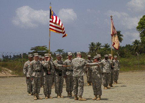 Col. Kimberly Daub, right, commander of the 101st Sustainment Brigade, Task Force Lifeliner, the logistical element for Joint Forces Command – United Assistance, and Command Sgt. Maj. Ian Griffin, the brigade senior enlisted advisor, case their unit's colors in a ceremony held in Buchanan, Grand Bassa County, Liberia, Feb. 24, 2015. The casing ceremony signifies the completion of the logistical mission for Operation United Assistance for the 101st Sustainment Brigade. (Sgt. First Class Mary Rose Mittlesteadt, 101st Sustainment Brigade (Lifeliners))