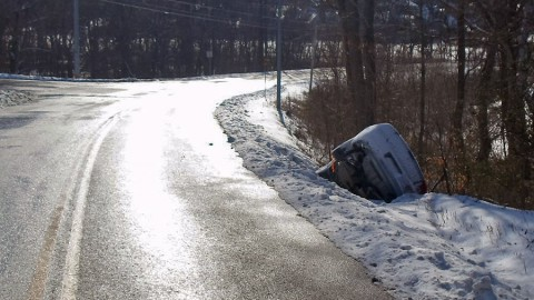 A car that slid off the road due to slick road conditions. (CPD Officer Coz Minetos