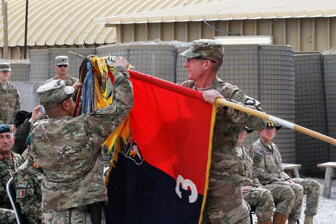 "Col. J.B. Vowell (right) and Command Sgt. Maj. Walter Tagalicud (left), the command team for the 3rd Brigade Combat Team ""Rakkasans,"" 101st Airborne Division, unfurl the unit colors during an uncasing ceremony Feb. 15, 2015, in Laghman Province, Afghanistan. The ceremony marked the brigade's fourth deployment to Afghanistan, now serving as combat advises to Afghan National Security Forces under Train Advise Assist Command-East. (Capt. Charlie Emmons, 3rd BCT Public Affairs)"