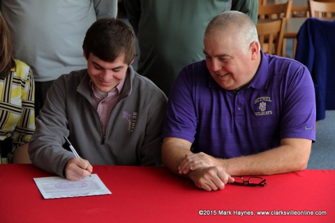 Montgomery Central's Tyler Britt signs golf scholarship with Bethel University.