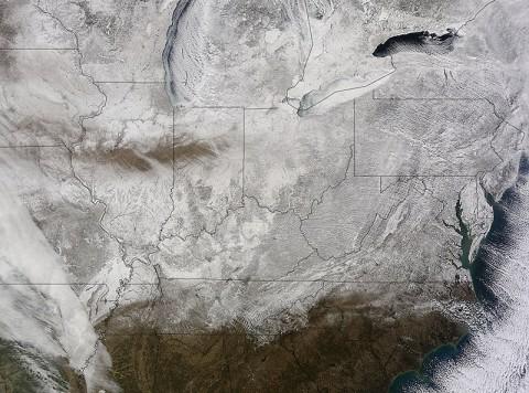 NASA's Terra satellite captured this picture of snow across the eastern United States on Feb. 19th at 16:20 UTC (11:20am EST). (NASA Goddard MODIS Rapid Response Team)