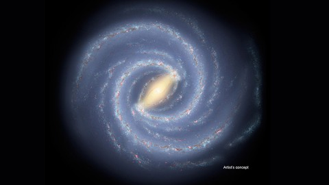 The newfound young star clusters lie thousands of light-years below the plane of our Milky Way galaxy, a flat spiral disk seen in this artist's conception. If alien lifeforms were to develop on planets orbiting these stars, they would have views of a portion, or all, of the galactic disk. (NASA/JPL-Caltech)