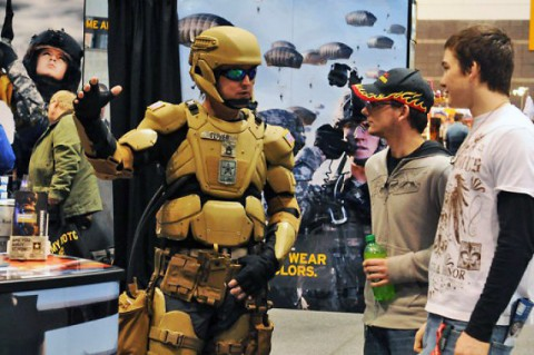 TALOS: Sgt. 1st Class Matthew Oliver suits up in a futuristic combat uniform with a Tactical Assault Light Operator Suit-like look at the 2012 Chicago Auto Show.