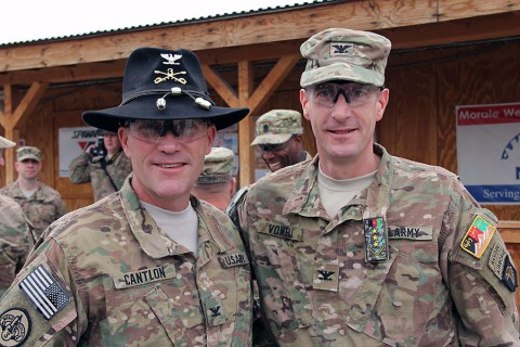 The 3rd Cavalry Regiment commander Col. Cameron Cantlon (left) and 3rd Brigade Combat Team, 101st Airborne Division (Air Assault) Commander Col. J.B. Vowell pose for a photo following the casing and uncasing ceremony held at Tactical Base Gamberi Feb. 15, 2015. (Capt. Jarrod Morris, TAAC-E Public Affairs)