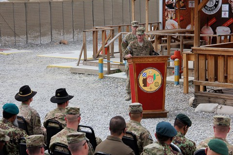 """Col. J.B. Vowell, the 3rd Brigade Combat Team, 101st Airborne Division (Air Assault) commander, speaks at the casing and uncasing ceremony held between outgoing 3rd Cavalry Regiment """"Brave Rifles"""" and incoming 3rd BCT """"Rakkasans"""" at Tactical Base Gamberi Feb. 15, 2015. (Capt. Jarrod Morris, TAAC-E Public Affairs)"""