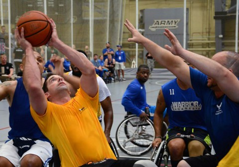 Staff Sgt. Brian Boone, Fort Sam Houston, Texas, maneuvers around his competitor for a layup during the during the game opener of Wheelchair Basketball competition June 16th at the 2014 U.S. Army Trials.